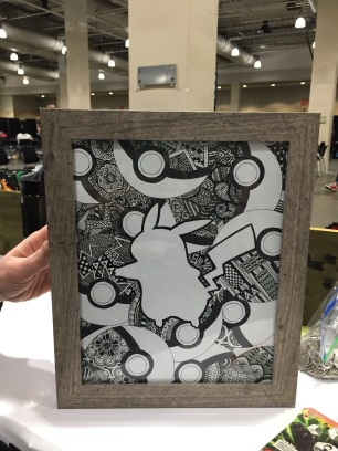 Another zentangle piece, featuring Pikachu's silhouette on a backdrop of Pokéballs. It didn't sell at the convention like the Link one did, but it still got a lot of compliments from my fellow nerds <3