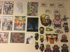 Some Perler bead buddies next to a few old concept art ideas, and Yzma from Emperor's New Groove, of course.
